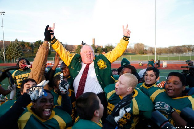 Rob Ford celebrating a victory with the football team his charity provides to underprivileged youth