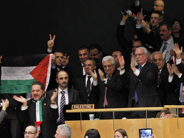 President of the Palestinian National Authority Mahmoud Abbas, center, celebrates with members of his delegation and other supporters after the U.N. General Assembly's historic vote to recognize Palestine as its 194th State at U.N - Photo by AP
