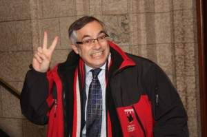 Tony Clement flipping Mr. Fraser the bird in both languages simultaneously.