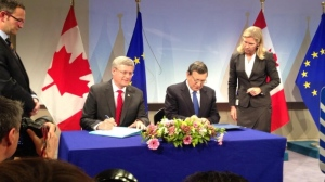 Canadian Prime Minister, Stephen Harper, signing EU/Canada free trade deal